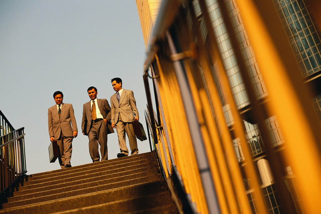 Businessmen at Top of Stairs